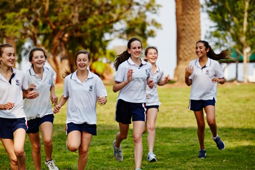 Wenona day girls and local and international boarders training for sport together in nearby parklands, girls' education, Wenona school sports , in North Sydney Australia, boarding school
