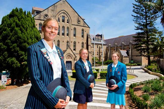 Senior Students standing in front of the Main Building